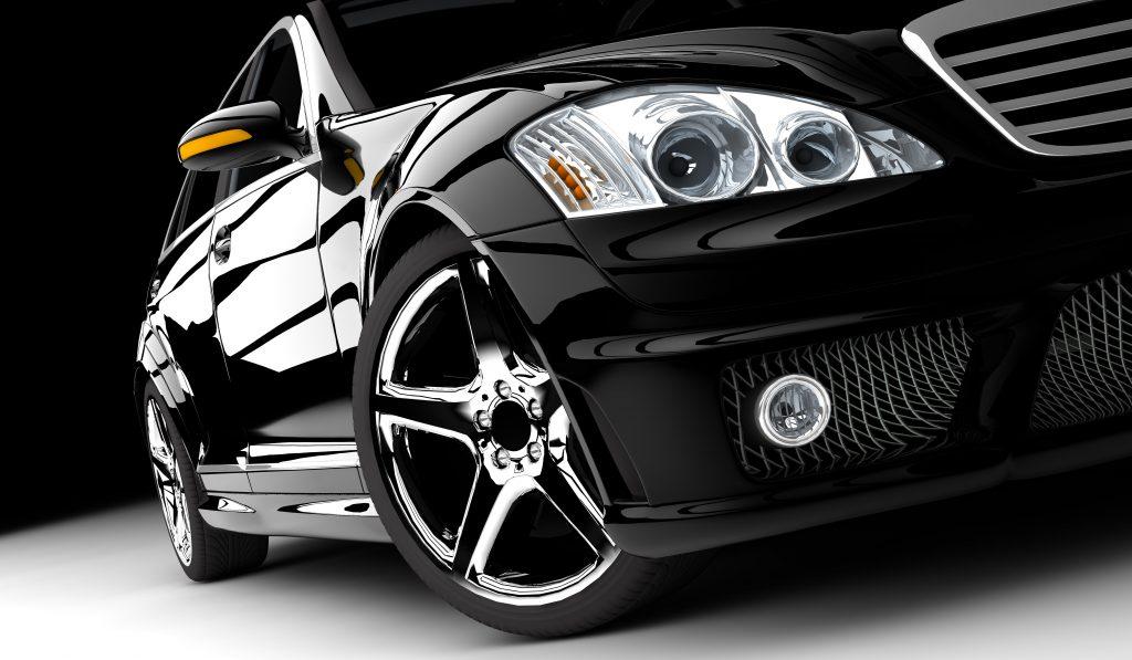 polished reflection black sedan