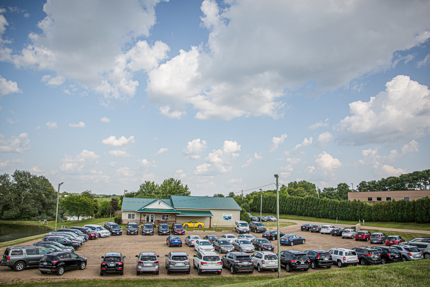Photo of the entire selection of preowned minivans, crossovers, trucks, SUVs and cars at Warehouse Auto near Cedar Rapids and Iowa city