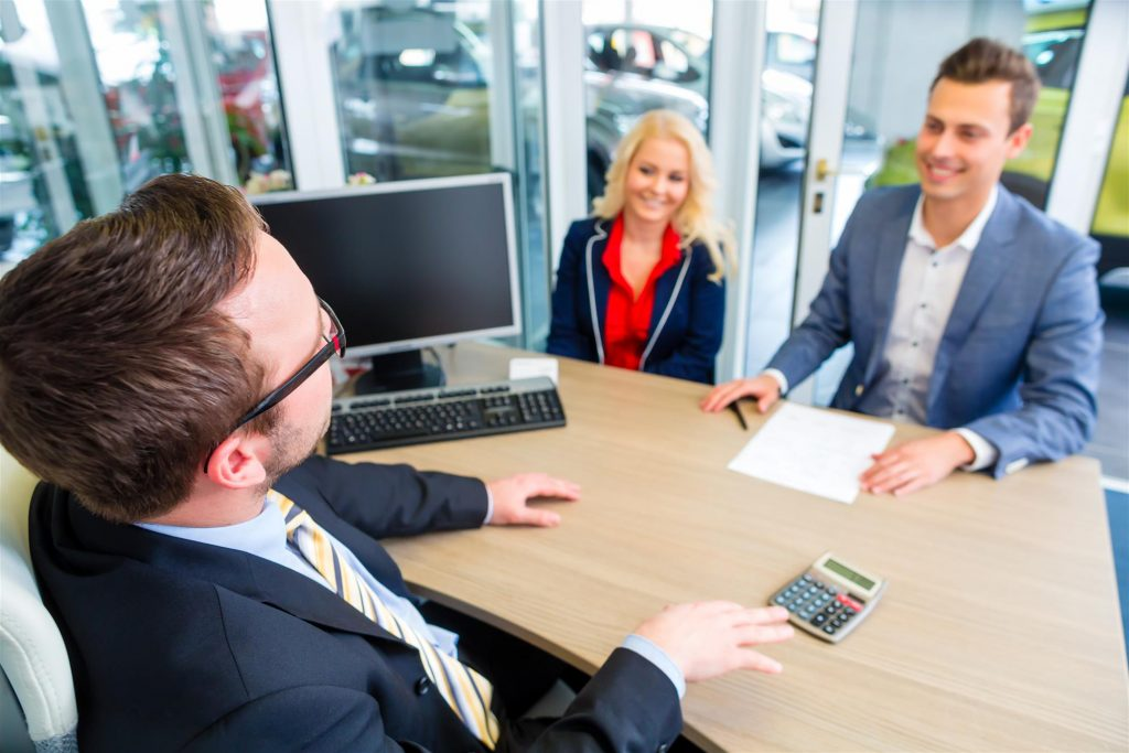 Salesman with prospective buyers