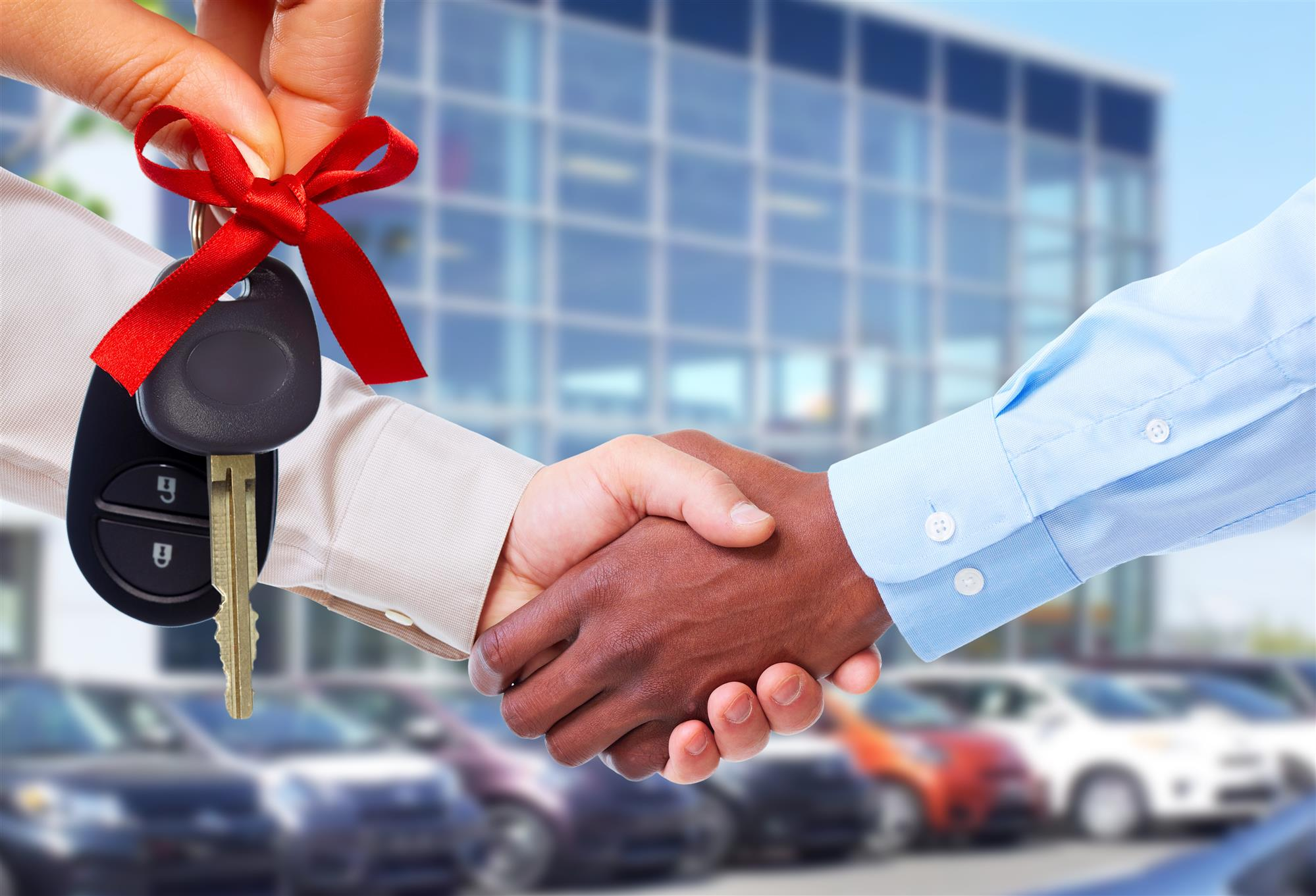 Shaking hands after buying a car