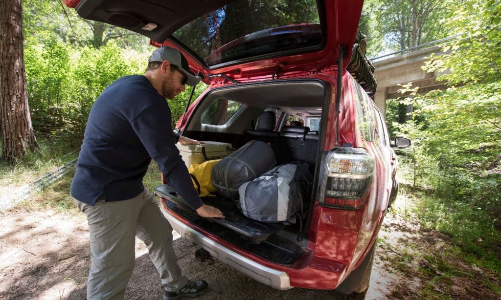 man looking at trunk of Toyota 4Runner