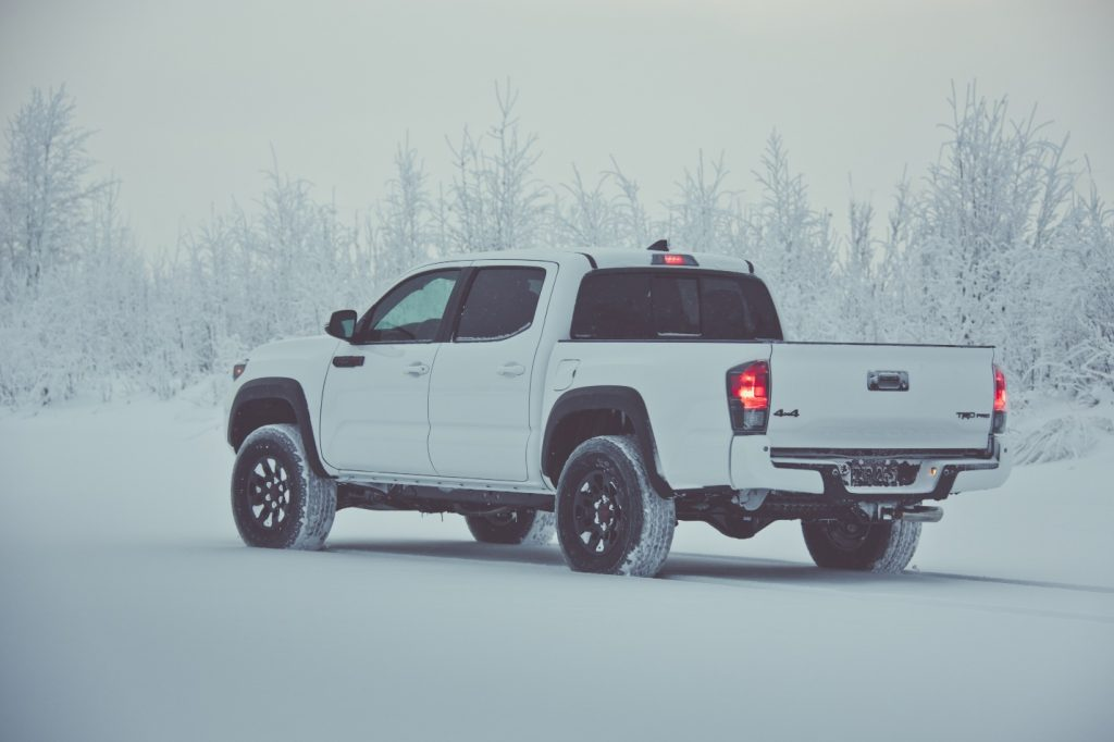 white toyota tacoma in the snow